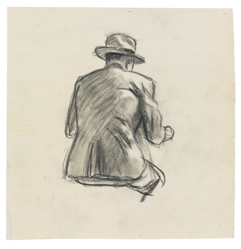Man in a suit sitting from behind.