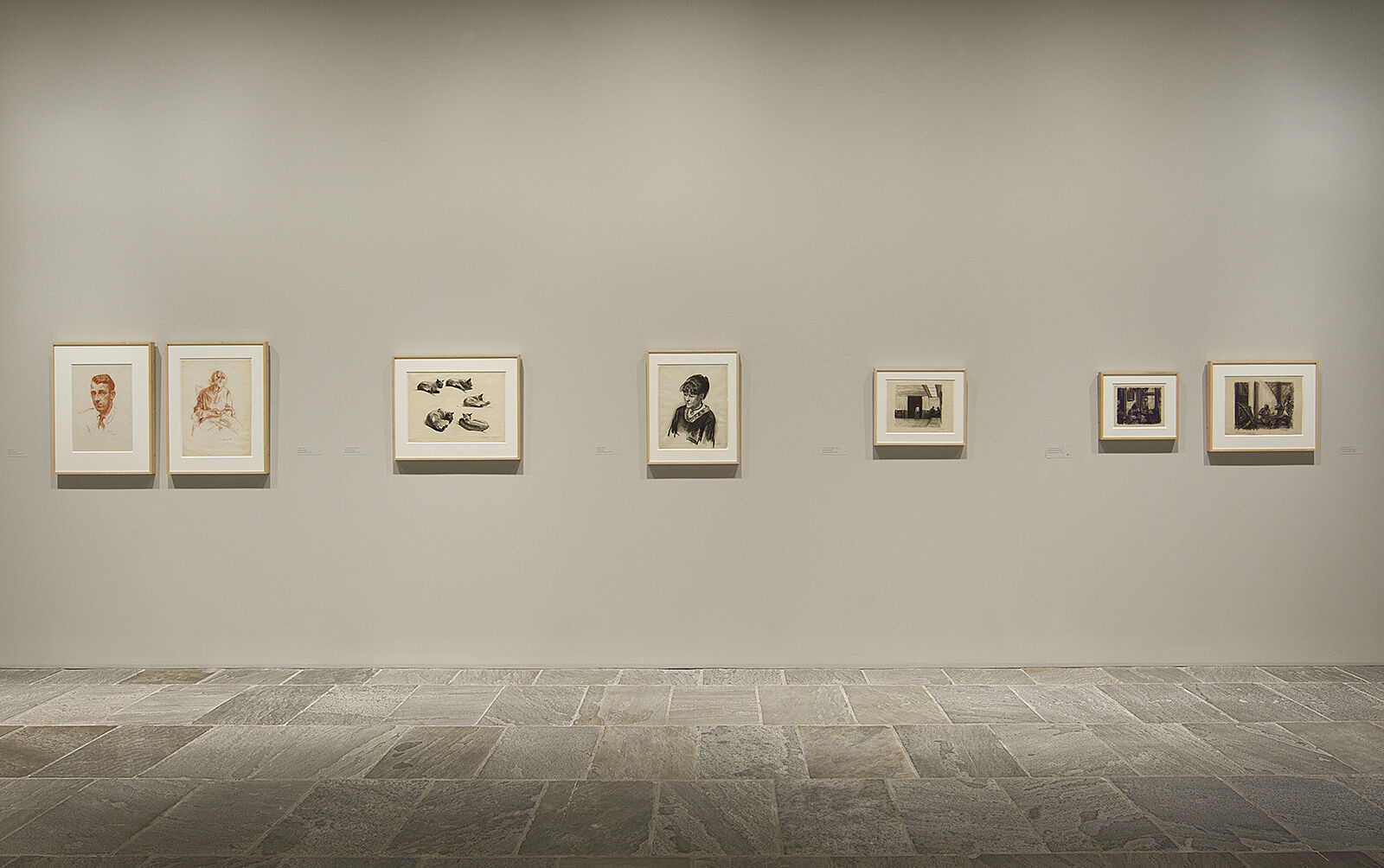 Sketches line the walls of the gallery.