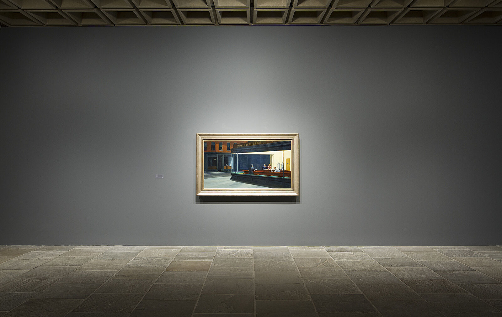 Nighthawks painting stands alone on a wall.