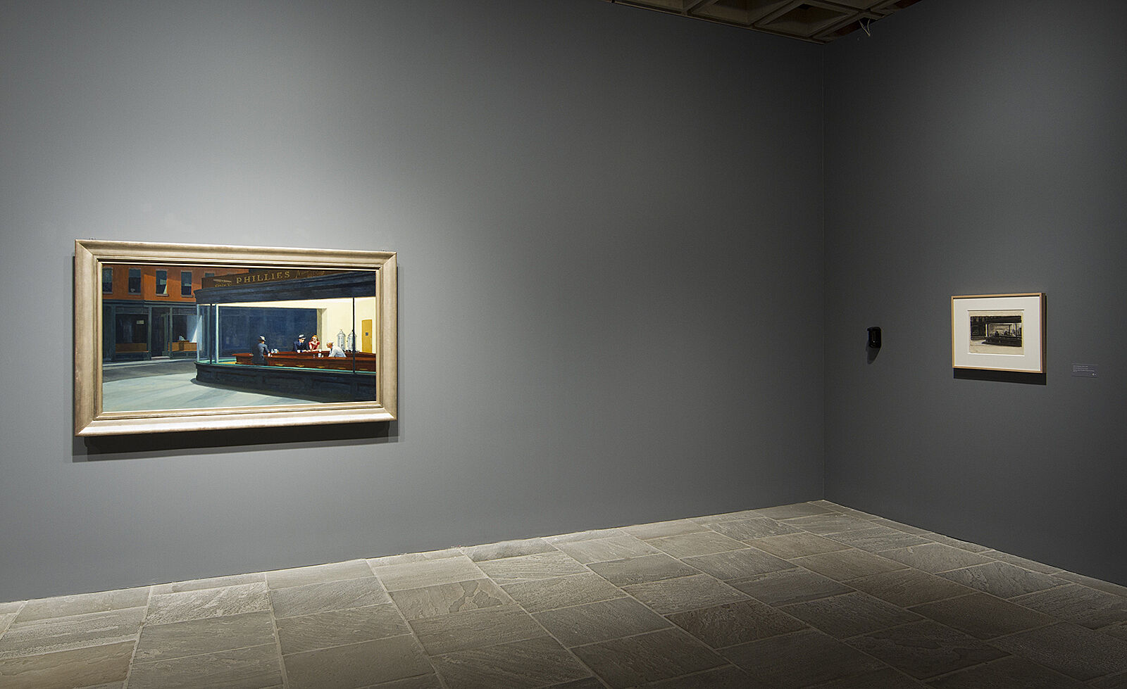 Nighthawks on one wall with sketch on adjacent one.