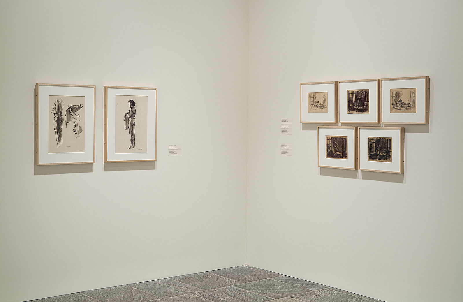 Corner of exhibit with drawings hanging.