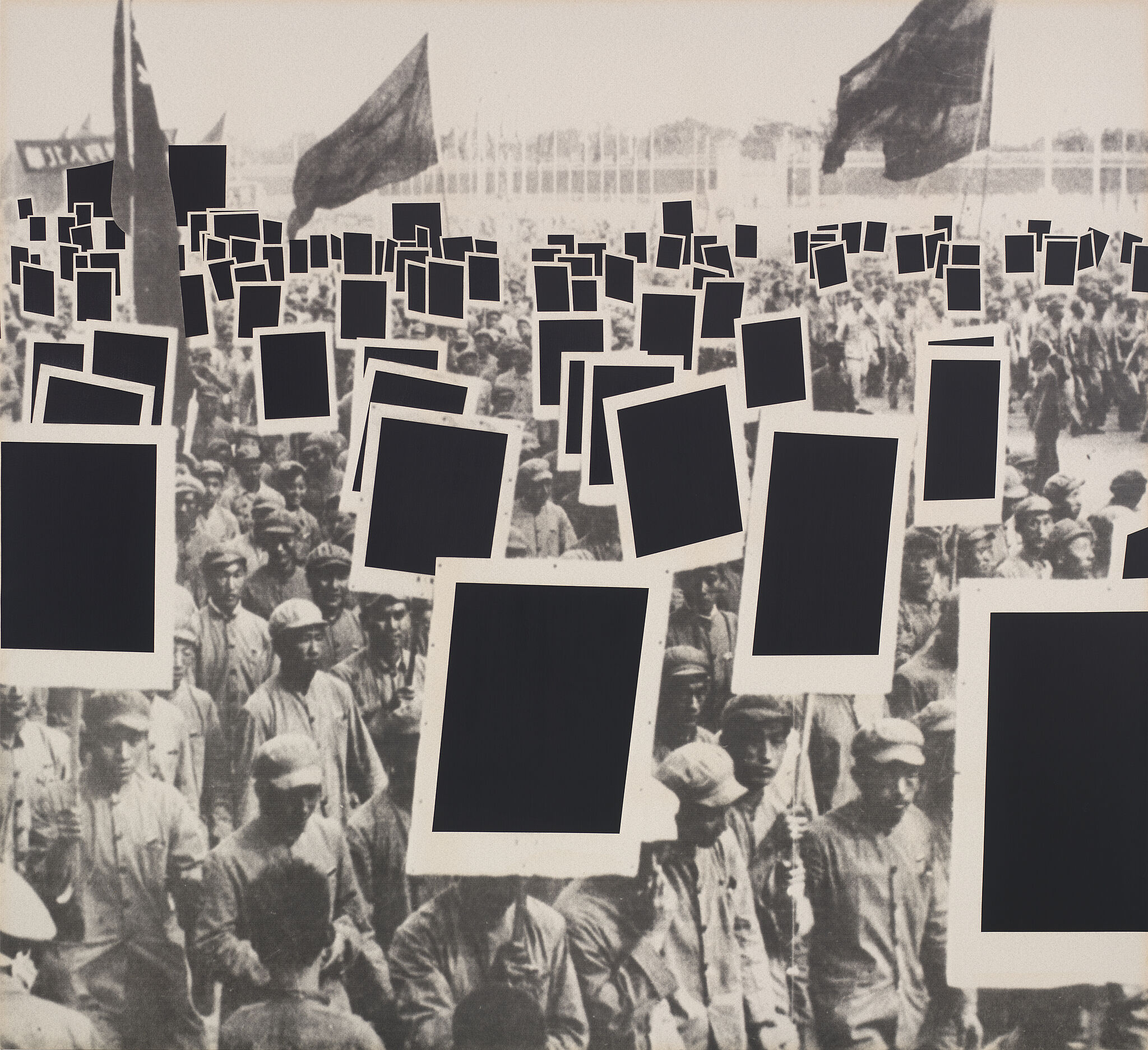 Black and white photograph of protesters with black rectangles covering their signs.