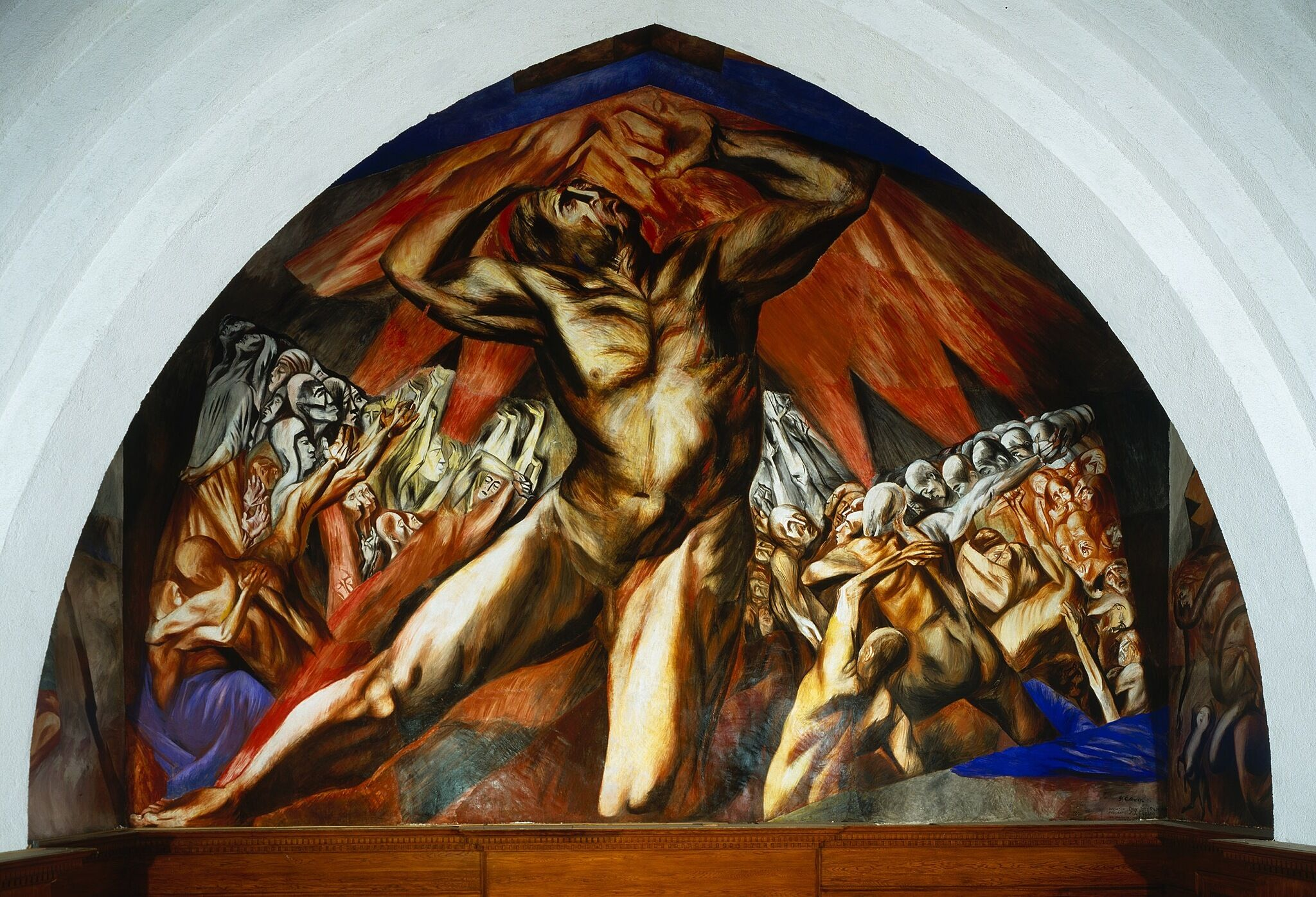 A photo of a mural depicting a tortured-looking man.